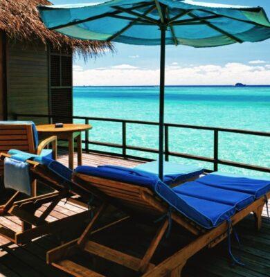 Cozy balcony furniture under an umbrella.