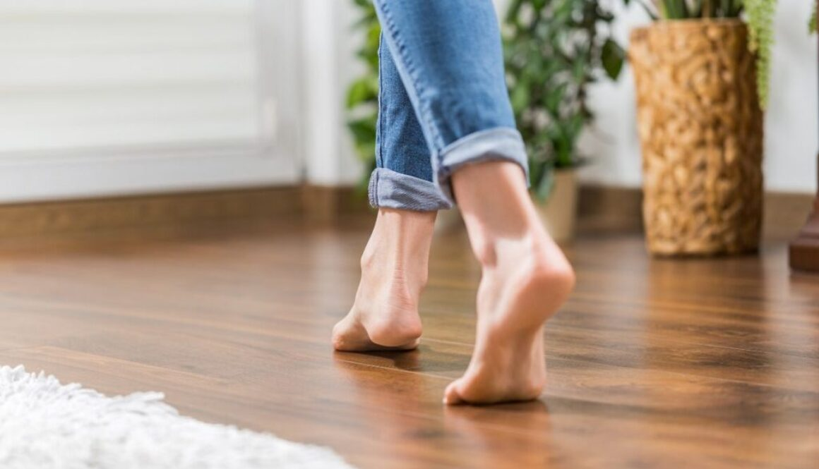 A woman walking on a floating floor.