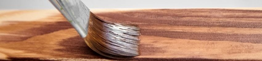 A photo depicting how to apply acrylic paint on wood.