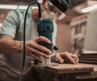 A carpenter using woodworking tools.