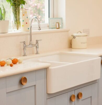 A beautiful farmhouse sink in a white kitchen.