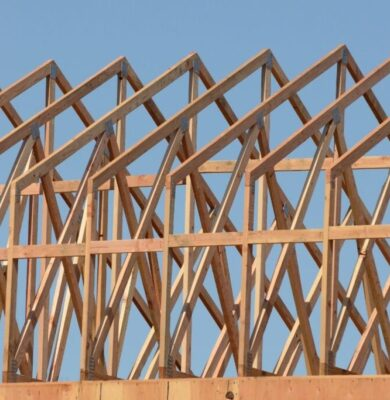 A row of roof trusses on an unfinished house.