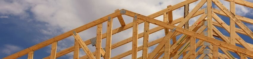 A set of roof trusses on a wooden frame.